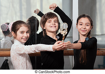 young dancers won the cup - Three young dancers won the cup