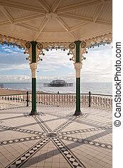 Brighton West Pier seen through victorian bandstand England...