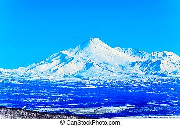 Russia, the Kamchatka Peninsula. Freeride skiing on...