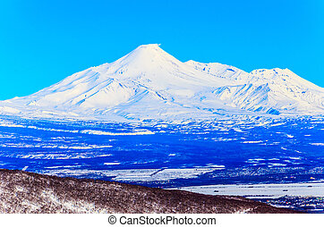 Russia, the Kamchatka Peninsula. Freeride skiing on...