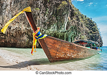 Traditional longtail boats in the famous Maya bay of Phi-phi...