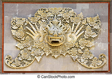 element design - Hundreds years old carving at Pura in Bali,...