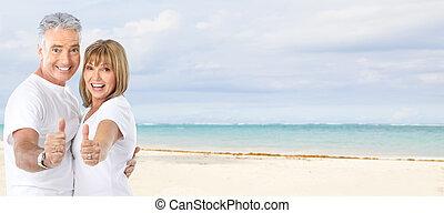 Happy senior couple on the beach Exotic luxury resort