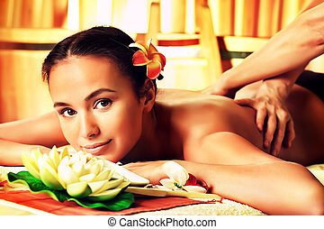 masseur - Beautiful young woman taking spa treatments at the...