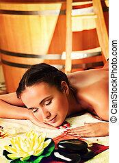 relaxing body - Beautiful young woman taking spa treatments...