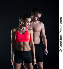 Fitness portrait - Young fitness models are posing in studio