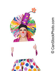 Funny girl clown with a blank advertising for text isolated...