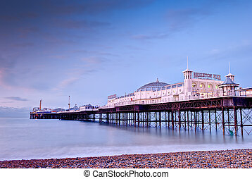 Brighton`s Beach Pier at sunrise , England.