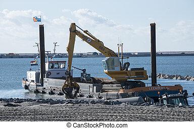 dredger ship working at Europoort in Holland - dredger ship...