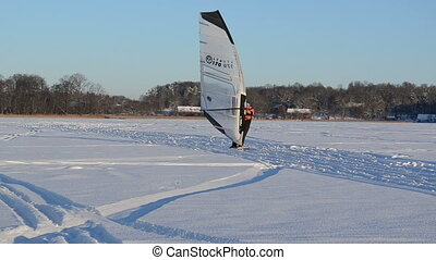 ice sail surf winter lake - people ice sailing surfing and...