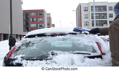 man clean snow car house