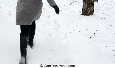 woman run snow winter - closeup of woman dressed in coat and...