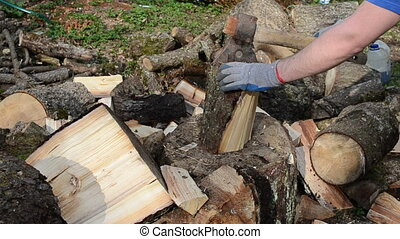 hand gloves chop wood axe - man hands with gloves chopping...