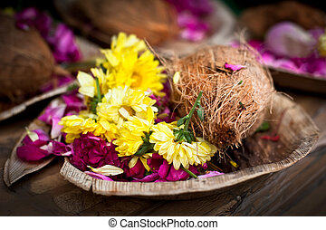 Flower and coconut offerings for Hindu religious ceremony or...