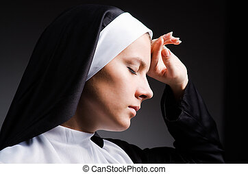 Young nun in religious concept