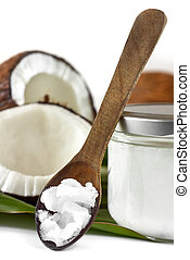Close-up of coconut oil on the wooden spoon. Beauty and...