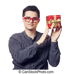 Young man holding red gift