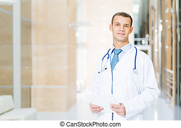 Portrait of doctor - Portrait of a doctor holding papers in...
