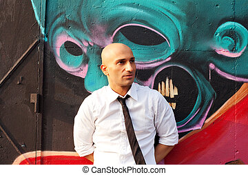 elegant man and graffiti in the street