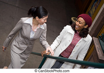Buiness Women in the City - Two business women having a...