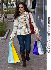 Pretty Girl Shopping - An attractive girl out shopping in...
