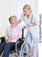 Caring Doctor Helping Handicapped Patient - Caring Doctor...