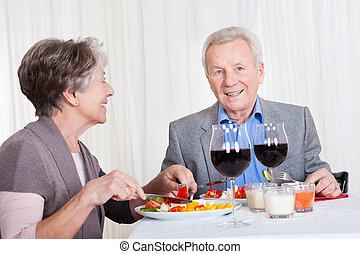 Senior Couple Enjoying Dinner Together - Portrait Of Senior...