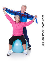 Portrait Of A Senior Couple Exercising