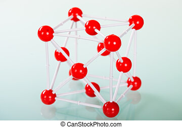 Model of copper molecular structure on green reflective...