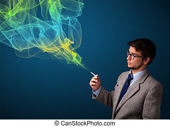 Handsome man smoking cigarette with colorful smoke -...