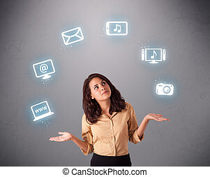 pretty girl juggling with elecrtonic devices icons - pretty...