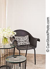 Brown rattan Chair in interior setting in front of a white...