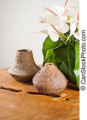 Vases and flowers as interior decoration on wooden table