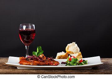 grilled pork steak on a platter