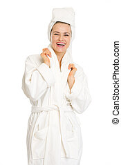 Portrait of smiling young woman in bathrobe