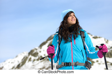 Beautiful woman winter hiking