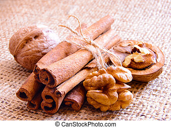Walnuts and Cinnamon on the Burlap Background