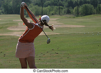 Lady golf swing action - lady golfer in action on course