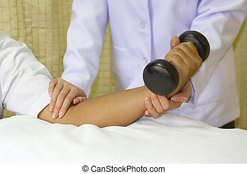 Rehab muscle training for elbow joint, physical therapist