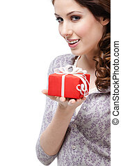 Enigmatic young woman hands a gift