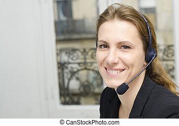Female customer service representative at her desk