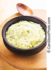 Mashed potato with dill in organic clay bowl