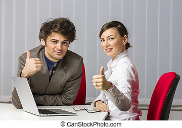 Thumbs up - Cheerful successful business team giving the...