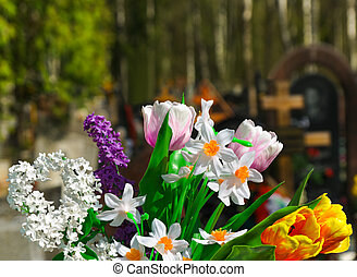 Flowers and cemetery on background