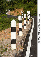 Stone pillars prevent accidents on the road curved