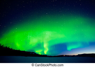Intense display of Northern Lights at morning dawn -...