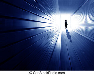 Tunnel and men - silhouette in a subway tunnel. Light at End...