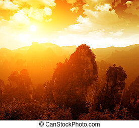 Sunset when the mountains - majestic sunset clouds and path...