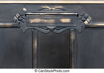 Old metal mailslot in balck door - Old metal mailslot in old...