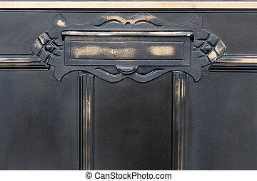 Old metal mailslot in balck door - Old metal mailslot in old...